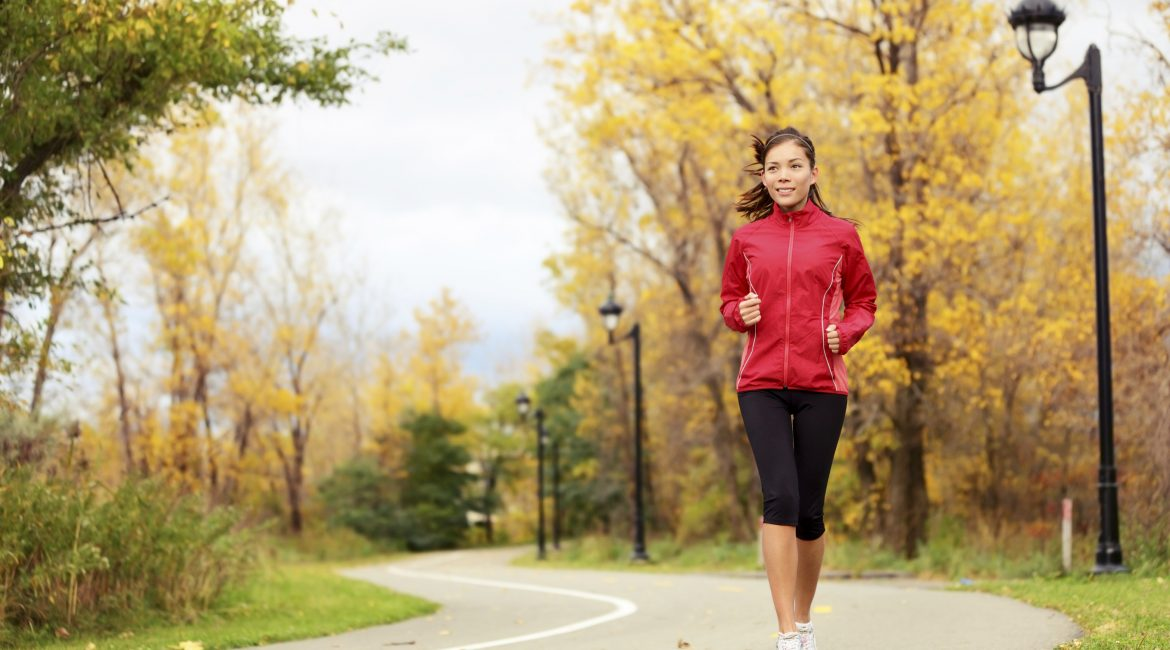 Fall running - xwoman jogging in autumn in city park. Female jogger training outside. Beautiful young multi-ethnic xwoman model in her twenties. Click for more: