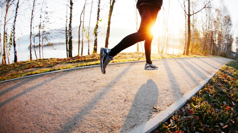 Man run at autumn morning. Healthy lifestyle concept