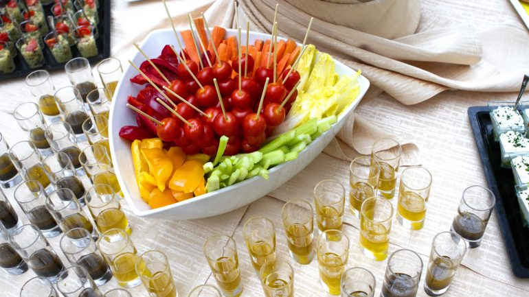 Vegetable crudite with cherry tomatoes, yellow peppers, celery and salad served with olive oil and vinaigrette.